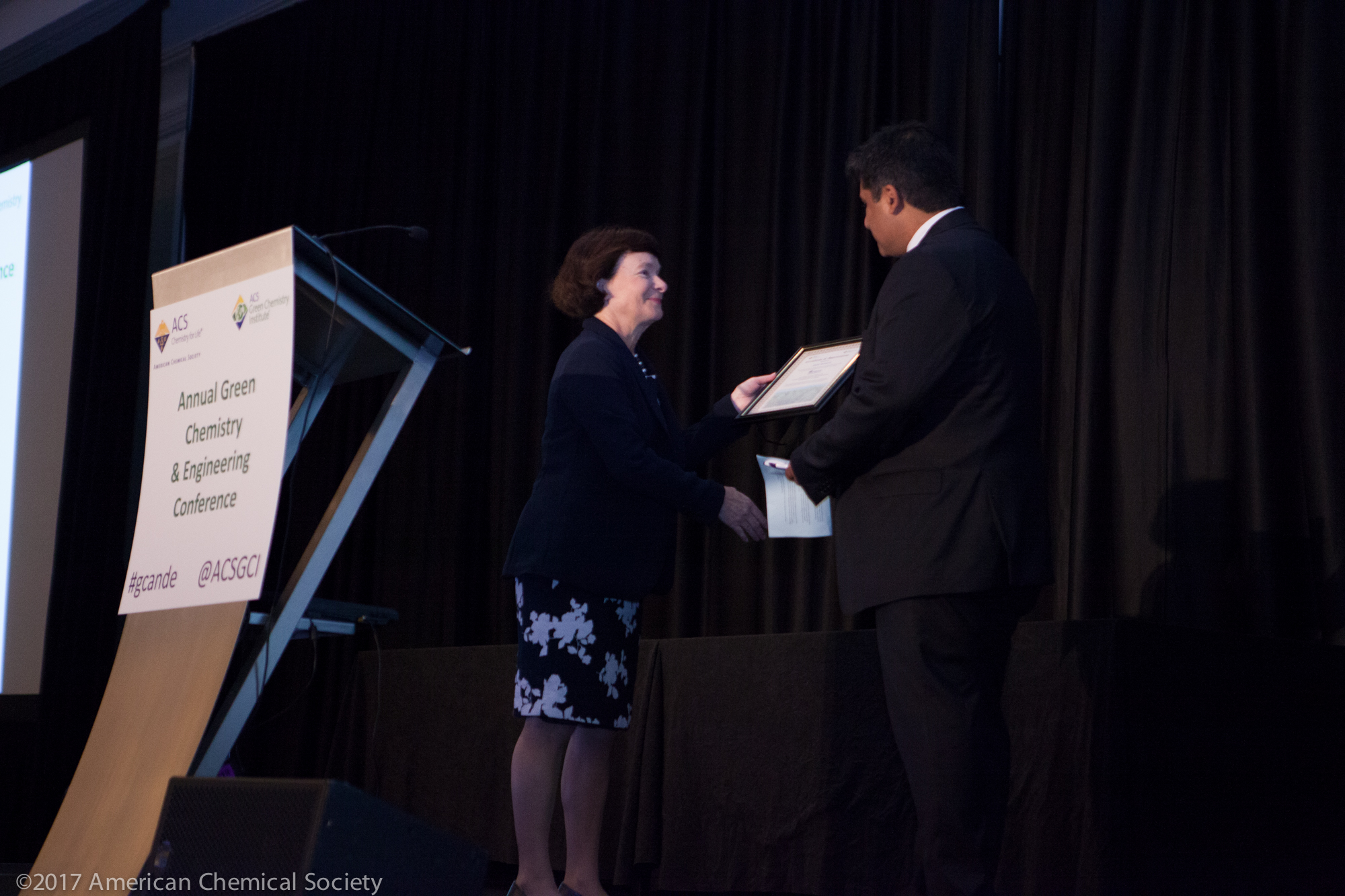 Mary Kirchhoff presents Amit Sehgal with a Certificate of Appreciation